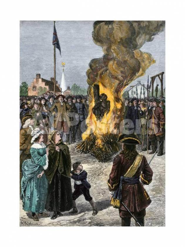 A slave is burned to death at the stake in New York City in 1741.